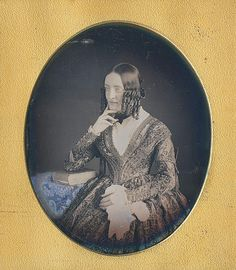 daguerreotype in quarter size lady in curls and beautiful patterned dress
