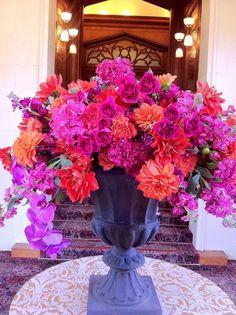 Pink and orange urn floral arrangement - pico soriano designs  #centerpiece  #radiantorchid #weddings