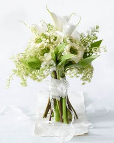 White and Green Bridal Bouquet, I like the flowers and unique shape of this bouquet but not the lace wrap holding it together.  I think something simple would be better.