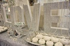 Diamonds ARE a Bride's Best Friend! Diamond and pearl dessert table set-up perfect for any wedding.