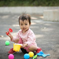"""With his growing manual dexterity and increasing mobility, your toddler is getting ready to graduate from rattles to """"big kid toys""""."""