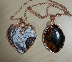 "Left is Mexican Crazy Lace Agate and the right is Coprolite (petrified dino poop). Both are wrapped in copper with sterling accents and will come with a 22"" inch adjustable chain.  $40 ea."