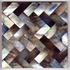 Gorgeous mother of pearl tile laid on a herringbone.