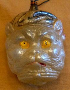 Cat wearing sleeping cap, German blown glass Christmas ornament, $129 eBay 12-17-2014