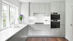 Built-in oven at eye level, Induction cooktop, Integrated rangehood, Fully integrated dishwasher 60 cm, Steam oven