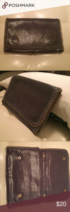 Stella McCartney style clutch Need a killer clutch? This grey, faux snakeskin clutch with gold chain trim goes everywhere. Looks similar to a Stella McCartney. 12 inches wide by 8 inches high Bags Clutches & Wristlets