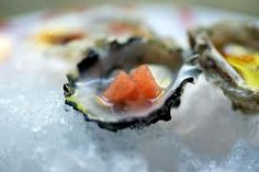 We will serve oyster with Matt's signature drink, a mix of sweet red vermouth, vodka, pomegranate juice, soda and a squeeze of lime, between the ceremony and reception