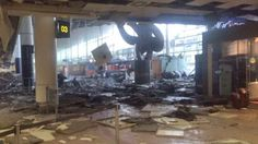 Obliterated: Ceiling tiles and debris are littered across the floor of the terminal buildi...