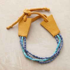 """PRAXIS BRACELET--Lapis and turquoise beads are left unpolished for a very matte, almost sand-like finish that reveals the gems' natural intensity. Designed by Renee Garvey with buttersoft deerskin ends and tie. Handcrafted in USA. Approx. 6-1/2"""" to 7-1/2""""L."""
