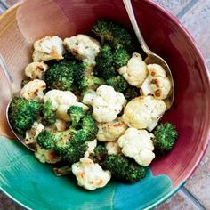 Oven Roasted Broccoli and Cauliflower takes on a whole new identity when cooked with high heat and only a little olive oil and seasoning.