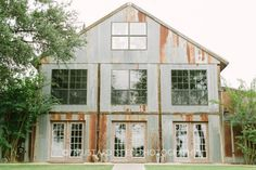Weathered wood + aged tin roof + stained concrete floors deep in Texas Hill County = rustic bohemian bridal chic at its finest. And how. | A private barn with a bohemian heart and modern touches. Bonus: bunk your bridal party in a freestanding cottage or treehouse!