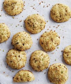 Full of bright lemon flavor and crunchy with cornmeal and green pistachios, these button cookies are a wonderful pick-me-up treat.