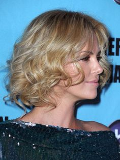 Charlize Theron  ~The bombshell actress's all-over soft ringlets give the illusion of layers adding movement to her featherweight locks.