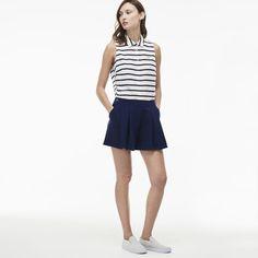 Des pinces élégantes équipent ce short Lacoste Live réalisé en crêpe de coton. Un modèle chic et féminin à associer à une blouse de saison.