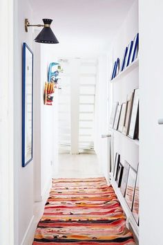 Struggling to decorate your long, narrow hallway? We have 19 long narrow hallway ideas that range in difficulty. From painting one wall to adding a long runner, we've got you covered. Turn your hallway into a library, or add shoe storage. Hallway Shelf, Hallway Paint, White Hallway, Hallway Storage, Entry Hallway, Hallway Ideas, Modern Hallway, Modern Staircase, Decorate Long Hallway