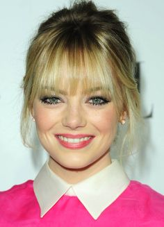Emma Stone stuns in platinum and pink diamond earrings at the Elle Women in Hollywood Celebration