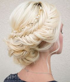 messy blonde updo with fishtail braid