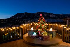 the cheyenne mountain resort outdoor spaces are illuminated with beautiful holiday lights and a tree - Christmas Mountain Resort