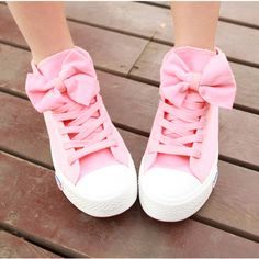 pink canvas shoes, love the bow effect. I would want me in purple or turquoise
