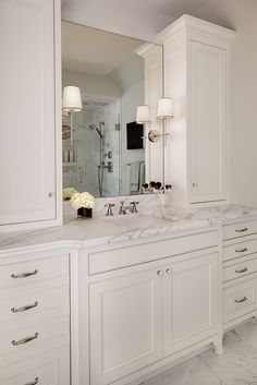 Master bathroom vanity with custom cabinetry and a marble top