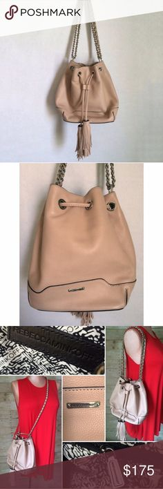 """Rebecca Minkoff Lexi Bucket Rebecca Minkoff Lexi Bucket in pale blush. Great roomy bag with drawstring closure. Can be worn on the shoulder or change strap to crossbody. Excellent, like new condition. Sorry, no dust bag included. Not interested in trades. 9""""W x 10""""H x 5.75""""D 12"""" doubled strap drop 23.5"""" singled shoulder strap drop Custom silver hardware One interior zipper pocket Three interior slip pockets Rebecca Minkoff Bags"""