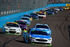 Ryan Blaney Photos - Ryan Blaney, driver of the #21 SKF/Quick Lane Tire & Auto Center Ford, leads a pack of cars during the Monster Energy NASCAR Cup Series Can-Am 500 at Phoenix International Raceway on November 12, 2017 in Avondale, Arizona. - Monster Energy NASCAR Cup Series Can-Am 500