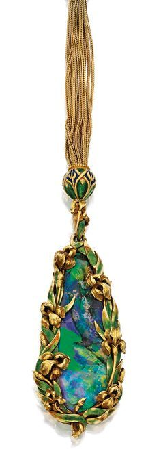 GOLD, OPAL AND ENAMEL SAUTOIR, MARCUS & CO. c1900. The drop-shaped black opal within a frame of gold irises accented by green enamel suspended from a multi-strand gold foxtail-link chain, slide bead and clasp with blue and green enamel, length approximately 18 inches.