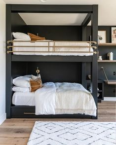 Painted bunk beds in dark moody color with light floors #bunkbeds #interiordesign