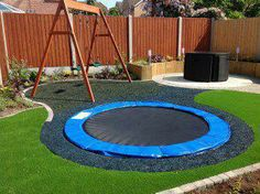 A sunken trampoline is safer for kids and looks really cool! + Recycled shredded tires as mulch for a softer landing. More at: www.diycozyhome.com