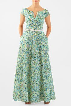 Ditsy florals add sweet summery dimension to our light cotton fit-and-flare maxi dress styled with a low split boat neck bodice.