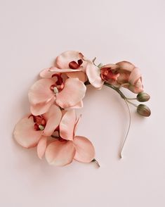 Get your side piece on. The Delaney crown has a metallic gold headband and features pink orchids asymmetrically arranged along one side. Shop orchid headbands at Rock N Rose! Gold Flowers, Flowers In Hair, Spring Flowers, Fascinator Headband, Crown Headband, Fascinators, Diy Hair Scrunchies, Silk Orchids, Flower Hair Pieces