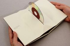 CD packaging that folds around the CD but pushes it up when opened!