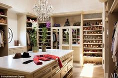 Living in style: Gisele and Tom opened the doors of their $20mil 'eco-friendly' Los Angeles home - featuring Gisele's huge walk-in-closet - ...