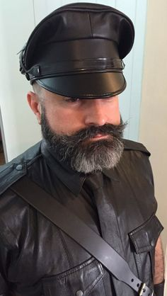 Gentleman's beard and leather muir cap. Woof!