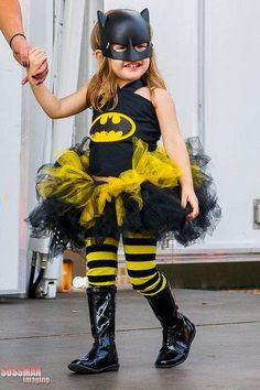 Put together this sleek Bat Girl costume by pairing a batman logo shirt with a…