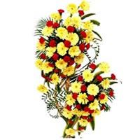 Tall two tier life-size arrangement of 50 Red carnations and 50 yellow gerberas decorated with long leafs.         Stylish and sophisticated, shop this thoughtfully designed life-size arrangement which is sure to win the hearts of your near and dear ones.         Please them all by sending this enchanting gift to India on a special occasion.        Height : Approximately 3.5-4 ft