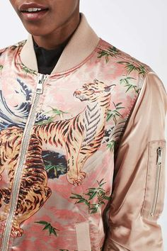 Revive your outerwear for the season change with this tiger embroidered bomber jacket with ma1 styling and zip-up fastening. This on-trend urban look is softened with the pink finish.