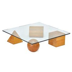 """LELLA VIGNELLI (b. 1934); MASSIMO VIGNELLI (1931 - 2014)  Metafora coffee table, Italy, 1980s Laminated and stained oak, glass Unmarked 12 1/2"""" x 47 1/2"""" x 48"""" (square top), 60"""" dia. (round top)"""