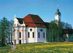 The Pilgrimage Church of Wies is an oval rococo church, located in the foothills of the Alps, in the municipality of Steingaden in the Weilheim-Schongau district, Bavaria, Germany. It is said that, in 1738, tears were seen on a dilapidated wooden figure of the Scourged Saviour. This miracle resulted in a pilgrimage rush to see the sculpture. Construction took place between 1745 & 1754, & the interior was decorated with frescoes & with stuccowork in the tradition of the Wessobrunner School.