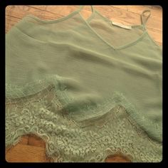 Delicate Sheer Mint Green Top This top is light and breezy. This mod color makes it a perfect addition to any closet and the lace trim makes you feel elegant and in charge Urban Outfitters Tops Tank Tops