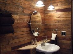 "small bathroom rustic pallet remodel, We used ""upcycled"" pallets used to cover walls, frame window, and build custom features including a ""barrel"" waste basket and door.  Rustic look of wood made to look even better with fixtures in brushed nickel and white porcelain, Bathrooms Design"
