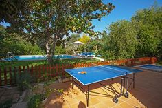 This villa in Pollensa, Majorca, comes with a fabulous garden area, with a table tennis table and a private pool. With a contemporary, homely interior, it is perfect for family getaways to Spain!