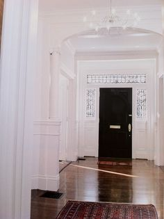 white foyer with black front door