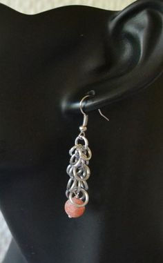 Exclusive earrings with red/orange frosted bead