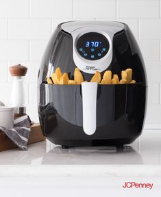 Tap to shop! // Getting your fried food fix just got a lot easier. Cook, serve and enjoy a healthier version of fried foods with the Power Air Fryer XL. By using less or no oil when preparing meals, this home cooker lets you fry, bake steam, roast, grill or saute your favorite foods, guilt free.