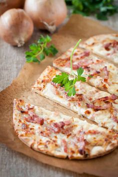 Flammekueche - A thin-crust pizza with crème fraîche, onions, and bacon that comes from Alsace, the French region at the border with Germany. It won't help you achieve your daily intake of vegetables but no vegetable tastes this good.