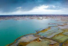 This photo was taken in the area of Guerande, Loire-Atlantique. In the image, an aerial view of the salt marshes. The salt marshes of Guerande produce some 10,000 tons of salt each year. Cette photo a été prise dans la région de Guérande, en Loire-Atlantique. À l'image, une vue aérienne des marais salants. Les salines de Guérande produisent quelque 10 000 tonnes de sel chaque année. Crédit :  Bruno Bouvry