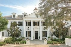 Rob Lowe's stunning white clapboard, Federal revival inspired home in Santa Barbara.