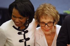 Former U.S. Secretary of State Condoleezza Rice (L) and former first lady of the United States Nancy Reagan walk together before Rice speaks at the Ronald Reagan Presidential Library July 14, 2009 in Simi Valley, California.