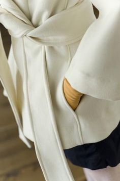 Sewing a coat: Tips for choosing a coat pattern and fabric (Close Up on Detail of White Vintage-Style Coat)